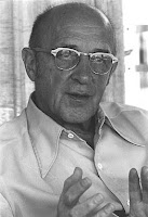Carl Rogers with glasses talking