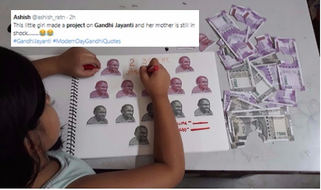 Picture of Girl Completing Gandhi Jayanti Project by Cutting Rs 500 & Rs 2000 Currency Notes