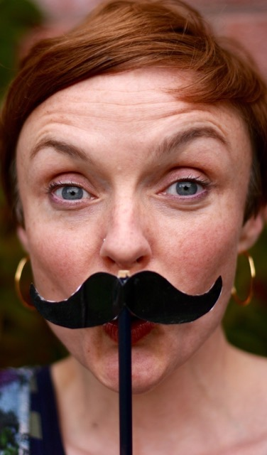 a false moustache on a woman.