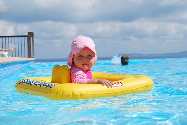 how to teach a toddler to swim, when can baby go in pool, how to teach a baby to swim