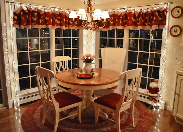 Christmas Kitchen including white lights on the windows around a round table