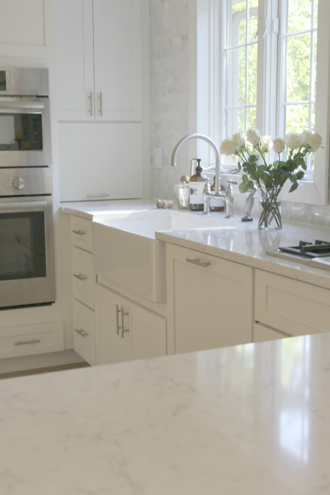 White modern farmhouse kitchen with Viatera quartz countertop - Hello Lovely Studio
