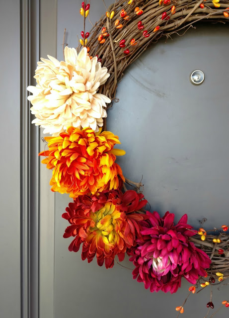 Wreaths are an easy way to add a little decor for any season.  This fall flowers and berries wreath can be made for less than 1/2 the price of a store bought one in about 30 minutes!