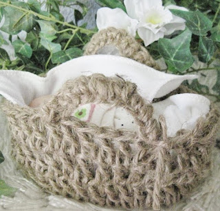 http://www.craftsy.com/pattern/crocheting/toy/jute-moses-basket-for-4-to-5-dolls/88043?SSAID=711462