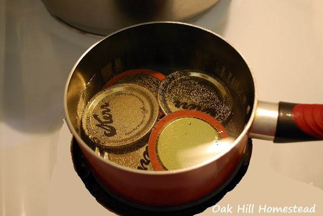 Warm the canning lids in simmering water before adding to the  jars.