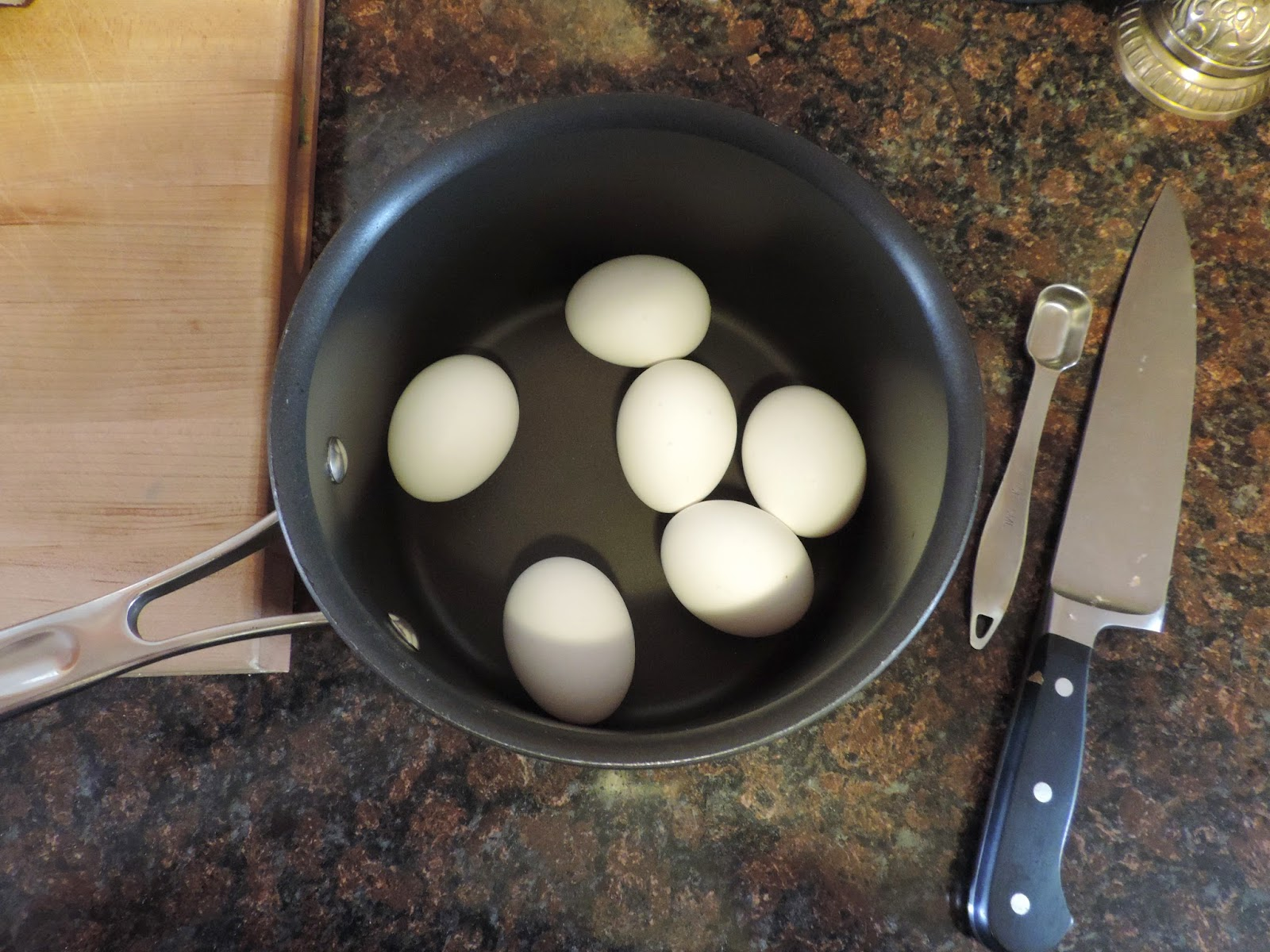 The eggs placed into an empty pot.