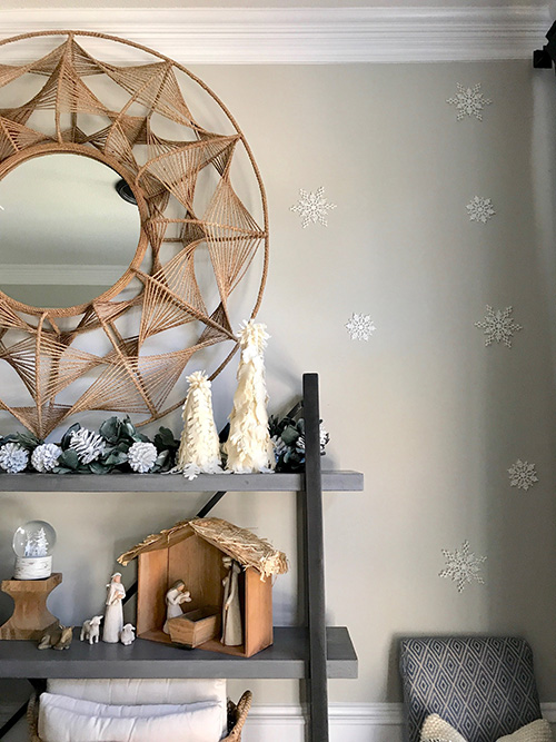 Cool  side of the shelves include the candlesticks from our wedding and my thrifted ice skates I love the way my cheap snowflake ornaments look on the wall