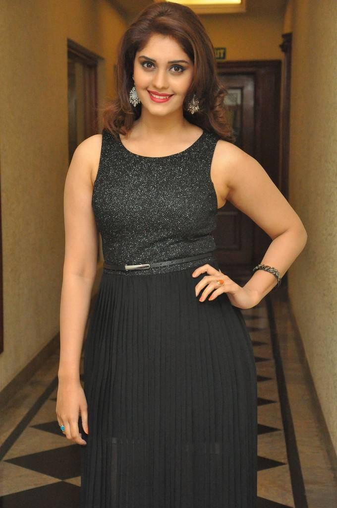 Actress Surabhi Stills At Audio Launch In Black Dress