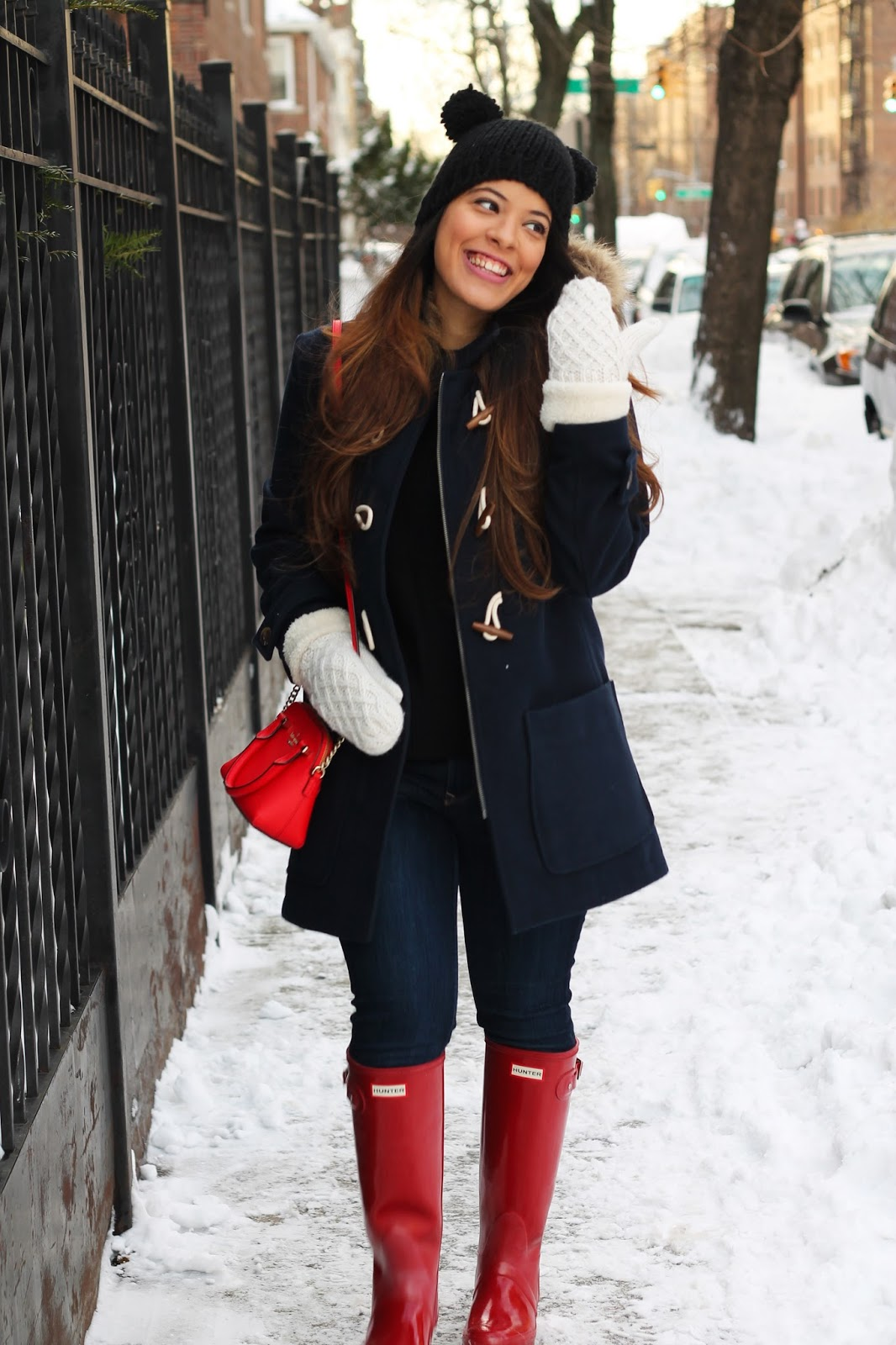 Navy Blue Toggle Coat and Red Hunter Rain Boots.