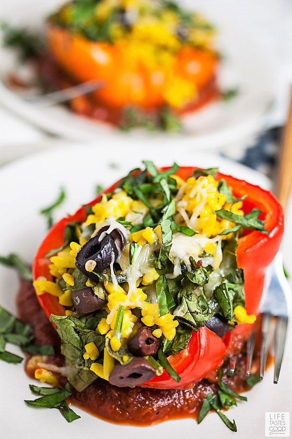 Vegetarian Stuffed Peppers with Orzo Pasta on a white serving plate ready to eat