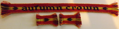 A photograph of the Autumn Crown prize tablet woven bands