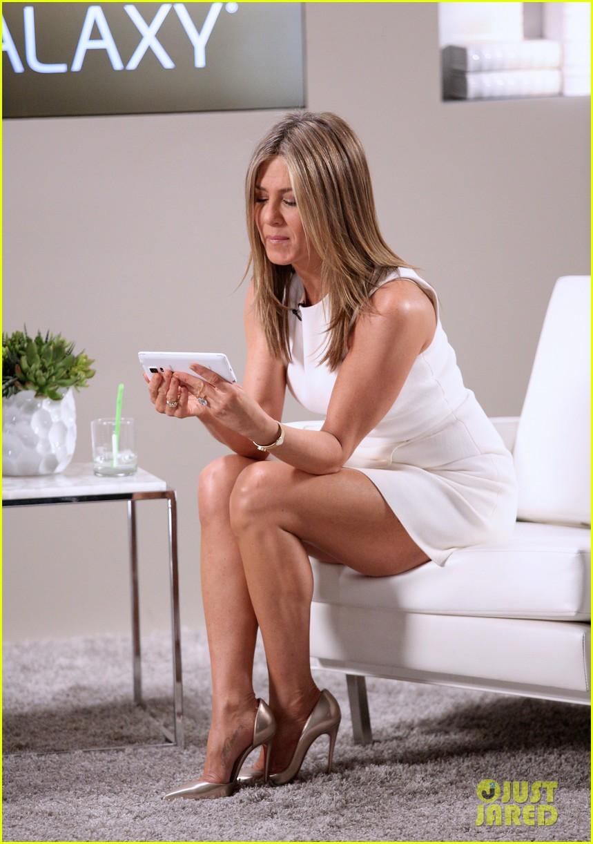 Jennifer Aniston legs show in short white dress