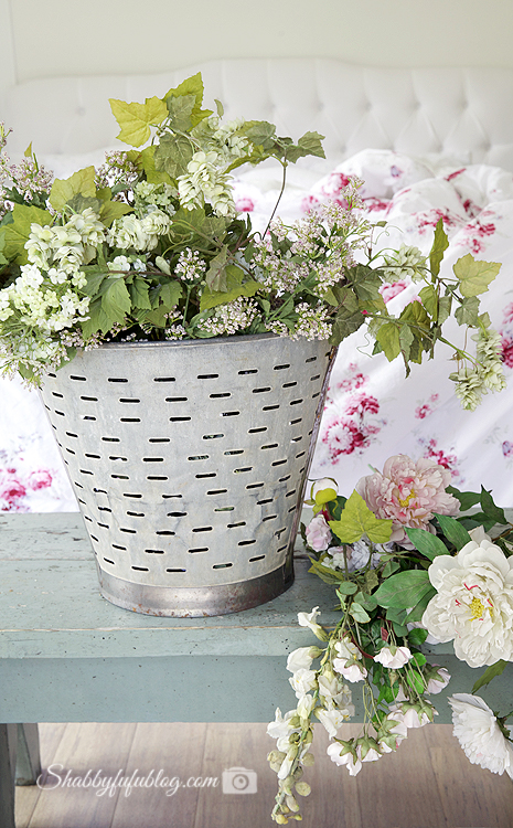 vintage olive bucket with flowers