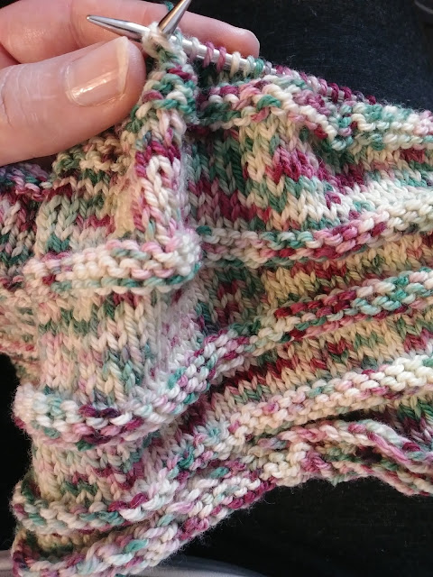 knitting a Simple Yet Effective scarf or cowl with Winter's Candy Cane merino wool.