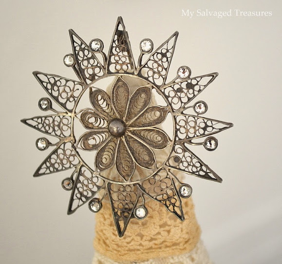 use an antique steel cut brooch as a Christmas tree topper