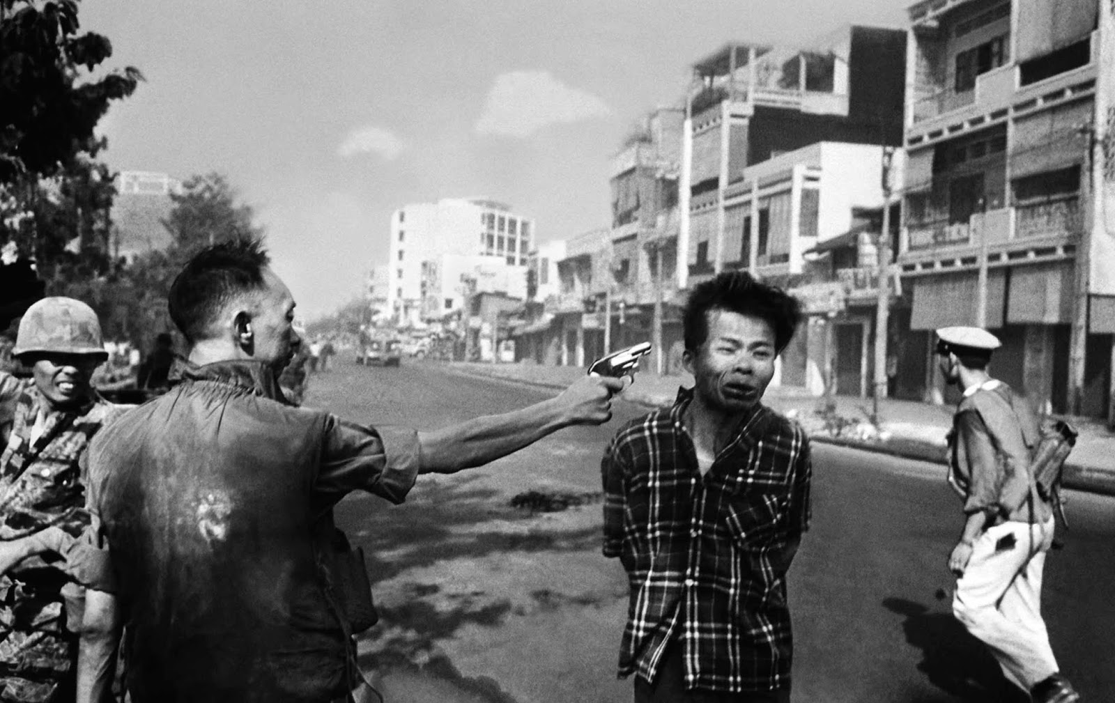 South Vietnamese Gen. Nguyen Ngoc Loan, chief of the national police, shoots Vietcong officer Nguyen Van Lem, also known as Bay Lop, on a Saigon street on Feb. 1, 1968.