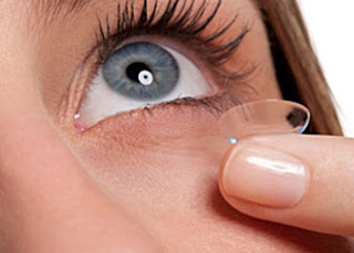 Girl inserting a contact lens