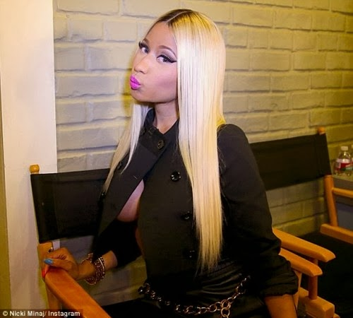 article 2431494 183D626300000578 805 634x571 Nicki Minaj flashes bóóbs in cropped unbuttoned jacket with no brá