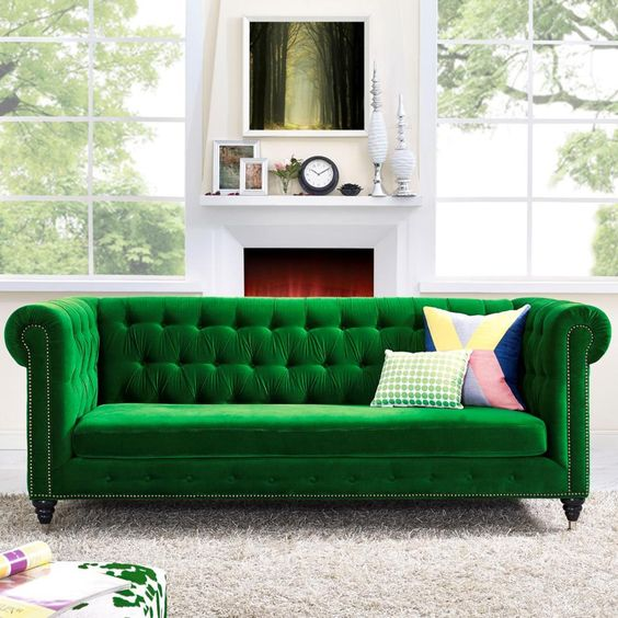 green velvet tufted sofa