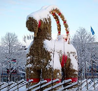 A giant straw goat statue dusted with snow