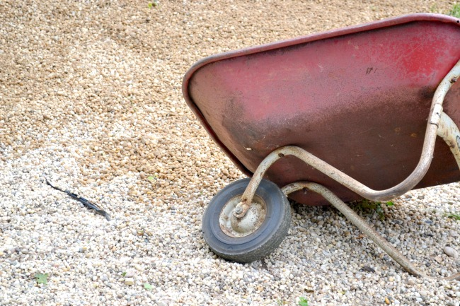 Wheelbarrow dumping pea gravel