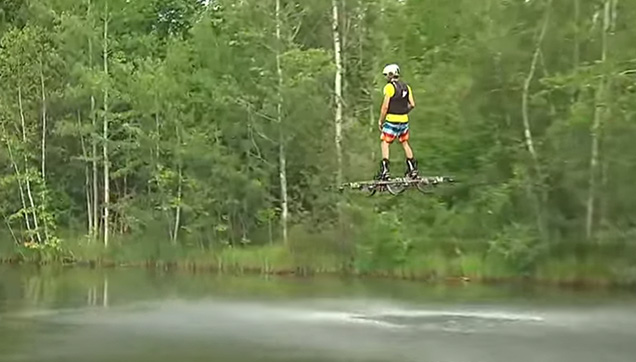 Catalin Alexandru Duru testing his hoverboard over the lake.
