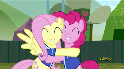 Fluttershy and Pinkie hugging
