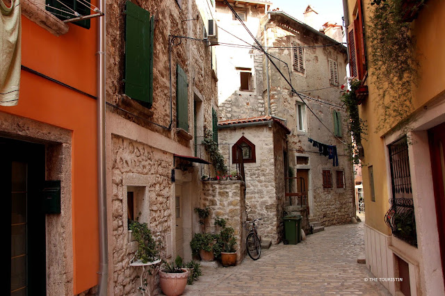 Rovinj, Croatia, Europe, old town. Umbrellas, washing lines, cafe, cobbled streets.