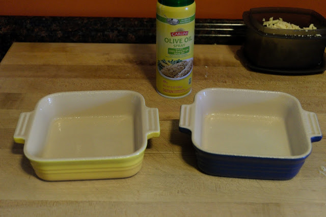 Two, single serving, baking dishes, on the counter, that have been sprayed with cooking spray.