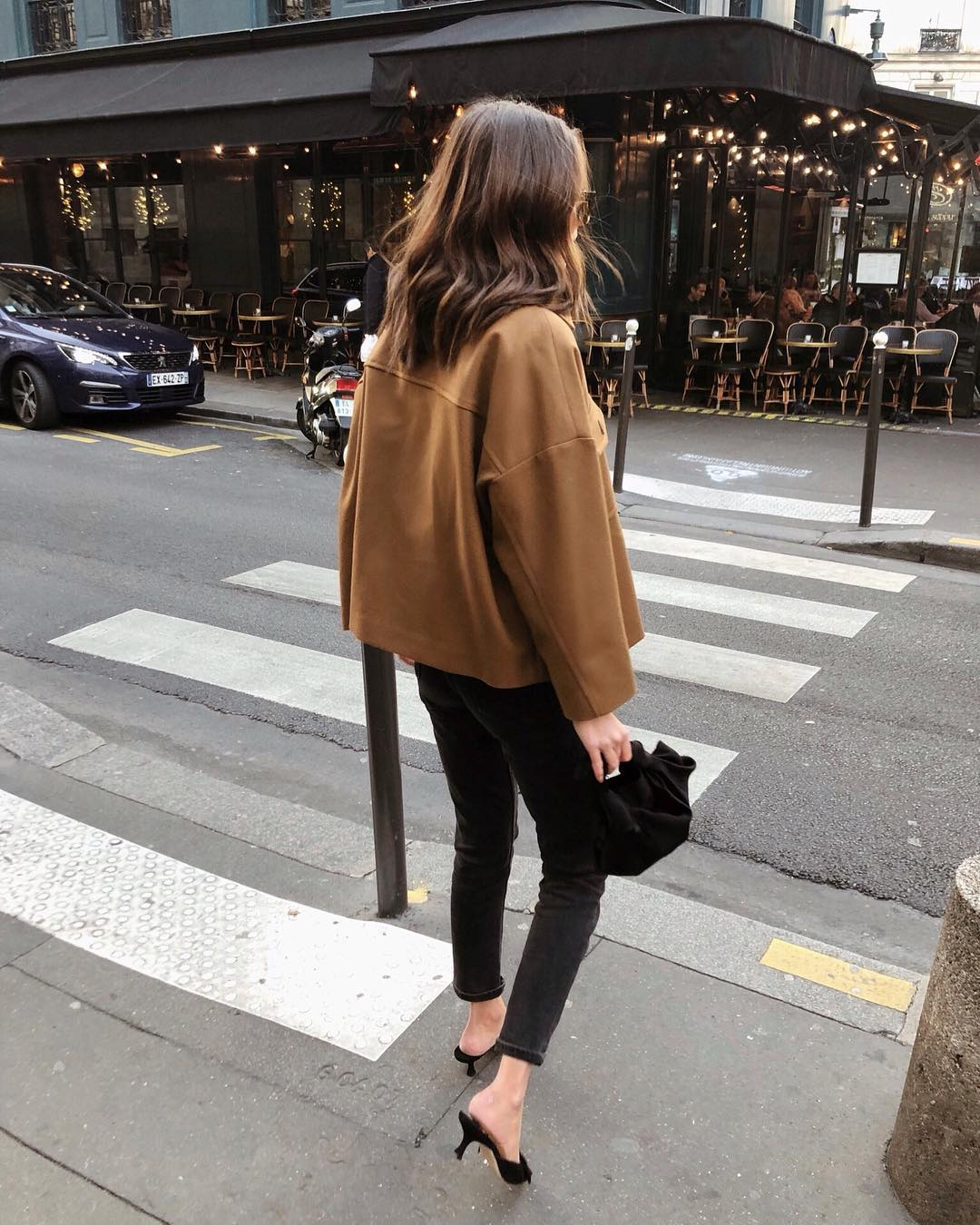 Stylish Instagram outfit idea for fall — camel jacket, black skinny jeans, and kitten heel mules