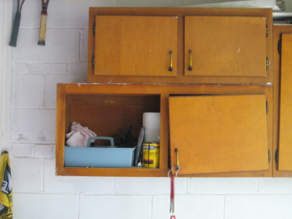 Taking off hardware: Painting old cabinets Recycled Cabinet Doors | DIY Playbook