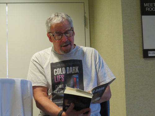 author Don Levin reading a book
