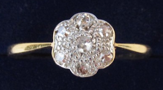Art Deco platinum and gold daisy diamond ring.