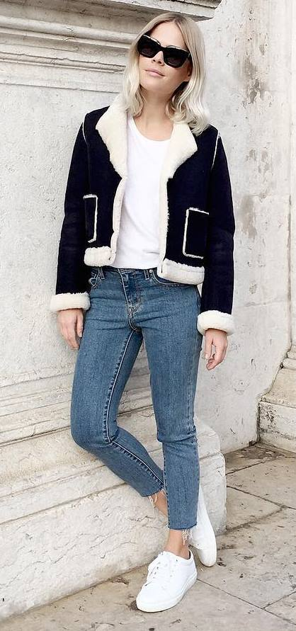 trendy fall outfit idea: jakcet + jeans + white sneakers + top