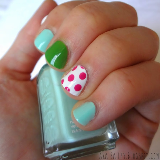 Essie Mint Candy Apple, with bright green and hot pink polka dot accent nails, perfect summer nails