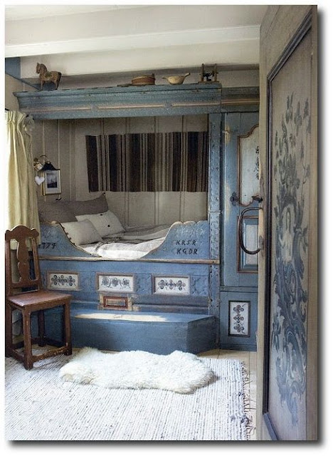 Breathtaking beautiful Swedish style folk art bedroom with built-in bed painted blue - found on Hello Lovely Studio