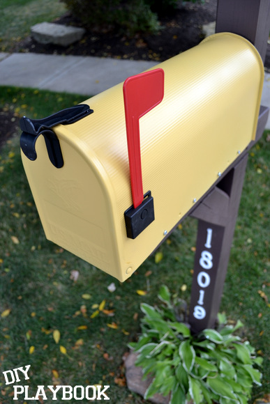 A bright new yellow mailbox for our front yard