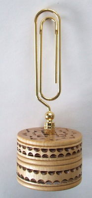 oversized paper clip memo holder, with hand-carved base