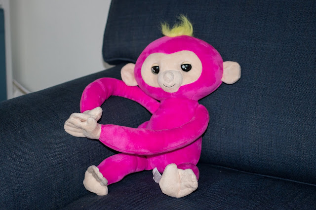 Bella the pink Fingerlings HUGS monkey chilling out of the sofa