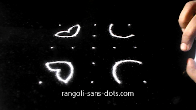 Simple-diya-rangoli-with-dots-1112a.jpg