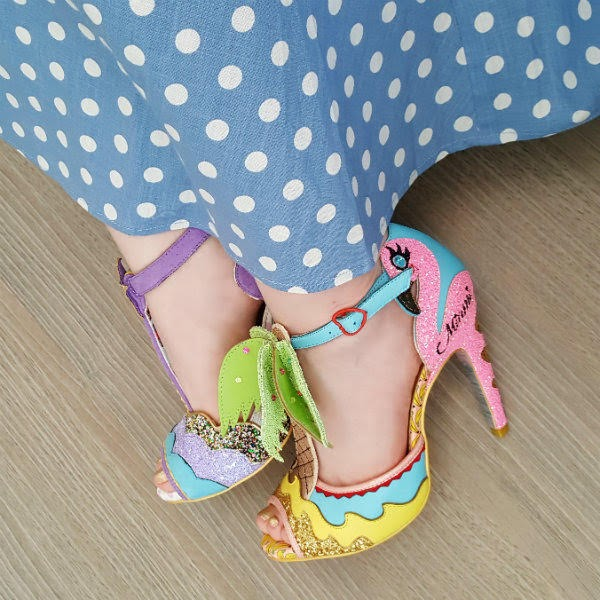 polka dot dress and foot wearing Miami theme flamingo shoe
