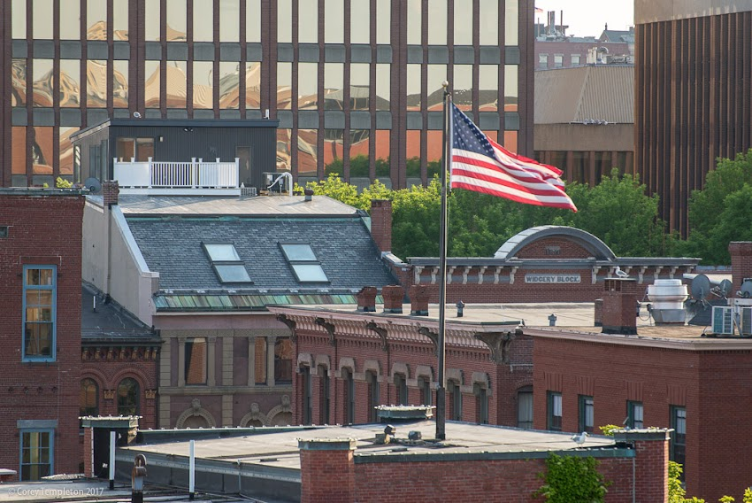 Portland, Maine USA June 2017 photo by Corey Templeton of an American flag catching some wind above the Old Port