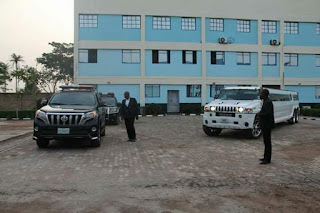 pastor living a lavishing life with his body guards infront of his cars and mansion