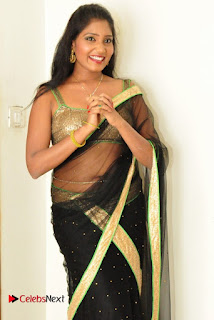 Actress Eeesha Chamundi Pictures in Black Transparent Saree  0022.jpg