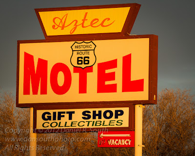 a photo of a motel sign on historic route 66 in seligman arizona