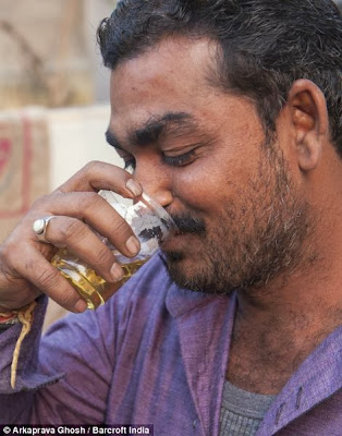 Photos: Hindu Worshippers Drink Virgin Cow Urine To Cure