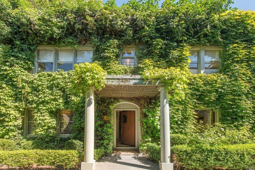 Ivy covered California home of Myra Hoefer with lush gardens and French inspired interiors. #ivy #climbingvines