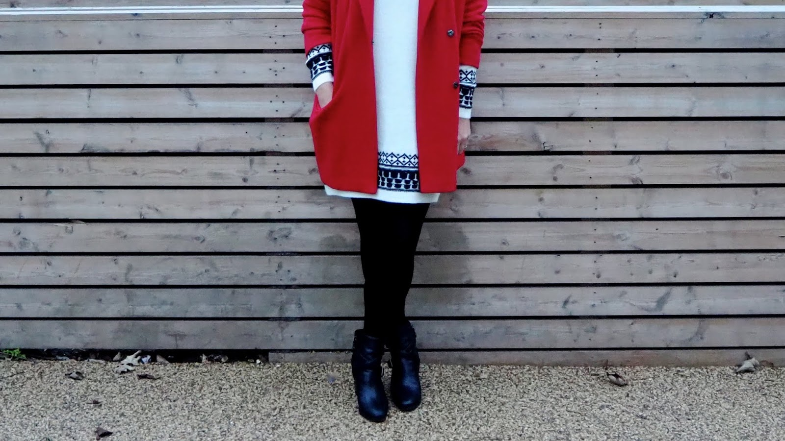 black and white fair isle sweater dress with red coat