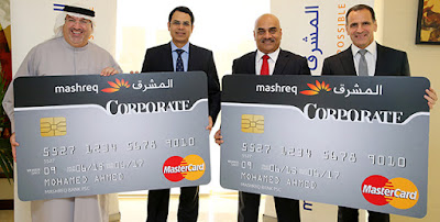 Executives hold mockups of the new corporate credit card from Mashreq Bank.
