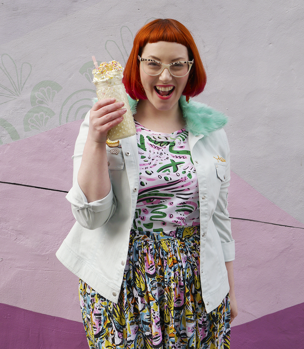 Styled by Helen, Wardrobe Conversations, Scottish Blogger, Edinburgh Blogger, Dundee Blogger, red head, ginger bob, Spex Pistols glasses, leopard print glasses, customised denim jacket, mint fur collar, Monki prints, Monki tshirt, Monki x Lynnie Zulu, Lynnie Zulu for Monki, River Island white lace up shoes, Rockcakes brooch, Rock Cakes pin badges, personalised denim jacket, Lucky Dip pins, milkshake with sprinkles, Roller Shakes, Blog Birthday, Style Diner, Kate George Mural Edinburgh, wall art Edinburgh, Edinburgh South side, Lou Taylor, tropical earrings